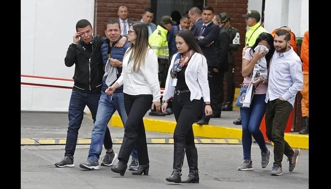 Death Toll In Colombia Bombing Rises To 21 As Threats Linger