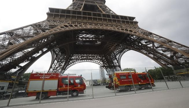 Eiffel Tower Closed Down After Intruder Tries to Climb Up