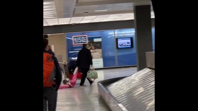 VIDEO: Man drags daughter through Dulles airport