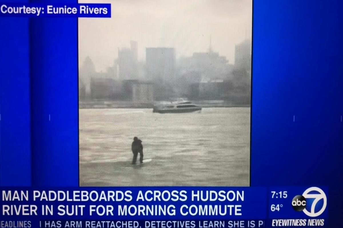 Watch: Man Commutes to Work by Paddle Boarding Across Hudson River in a Suit