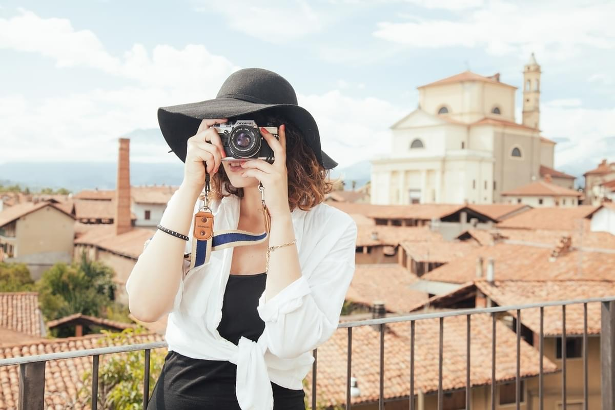 Get paid $100k to travel and take photos