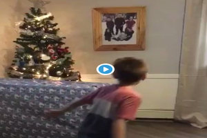 Boy opens Christmas present early to find military dad inside!