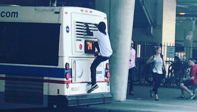 Man Caught on Camera Riding on Top of CTA Bus in Chicago | 101WKQX