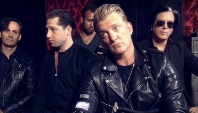 Watch Queens of the Stone Age get villainous in the UK before TNWSC