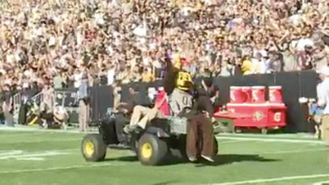 Mascot fires t-shirt gun into crotch, carted off the field to cheers