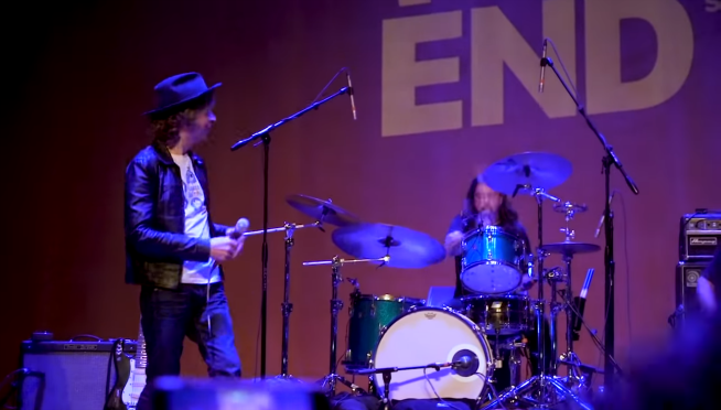 "Dave Grohl jumps on stage with Beck for ""Where It's At."""