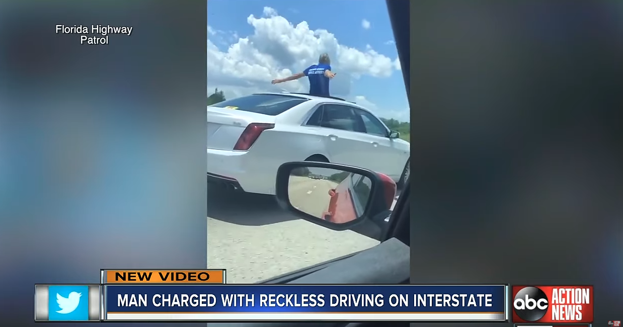 WTF News: Driver caught standing through sunroof