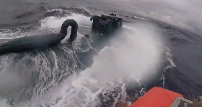 Coast guardsman says f*** it and jumps on top of a narcotics submarine