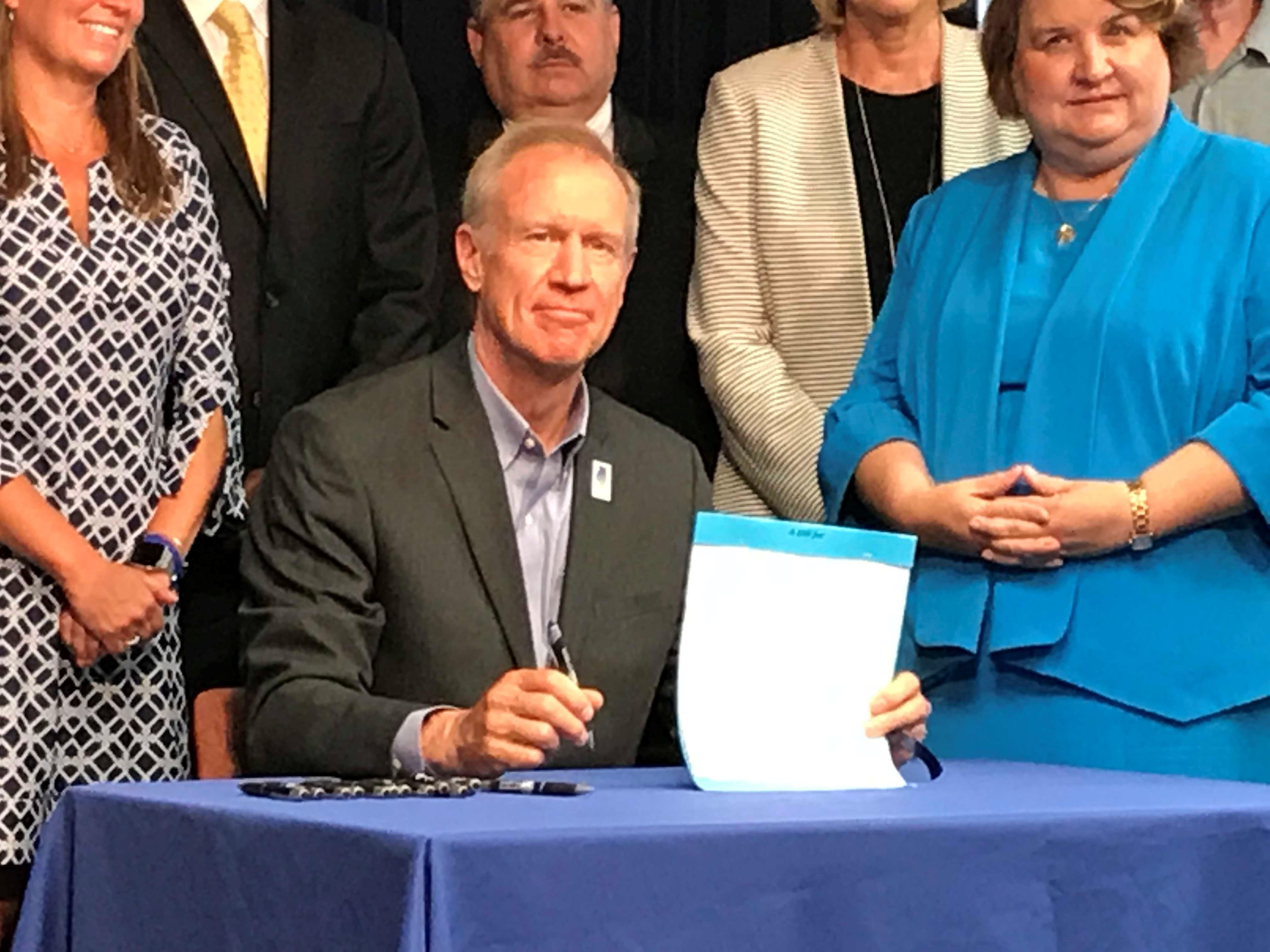 Rauner signs gun order of protection, waiting period laws