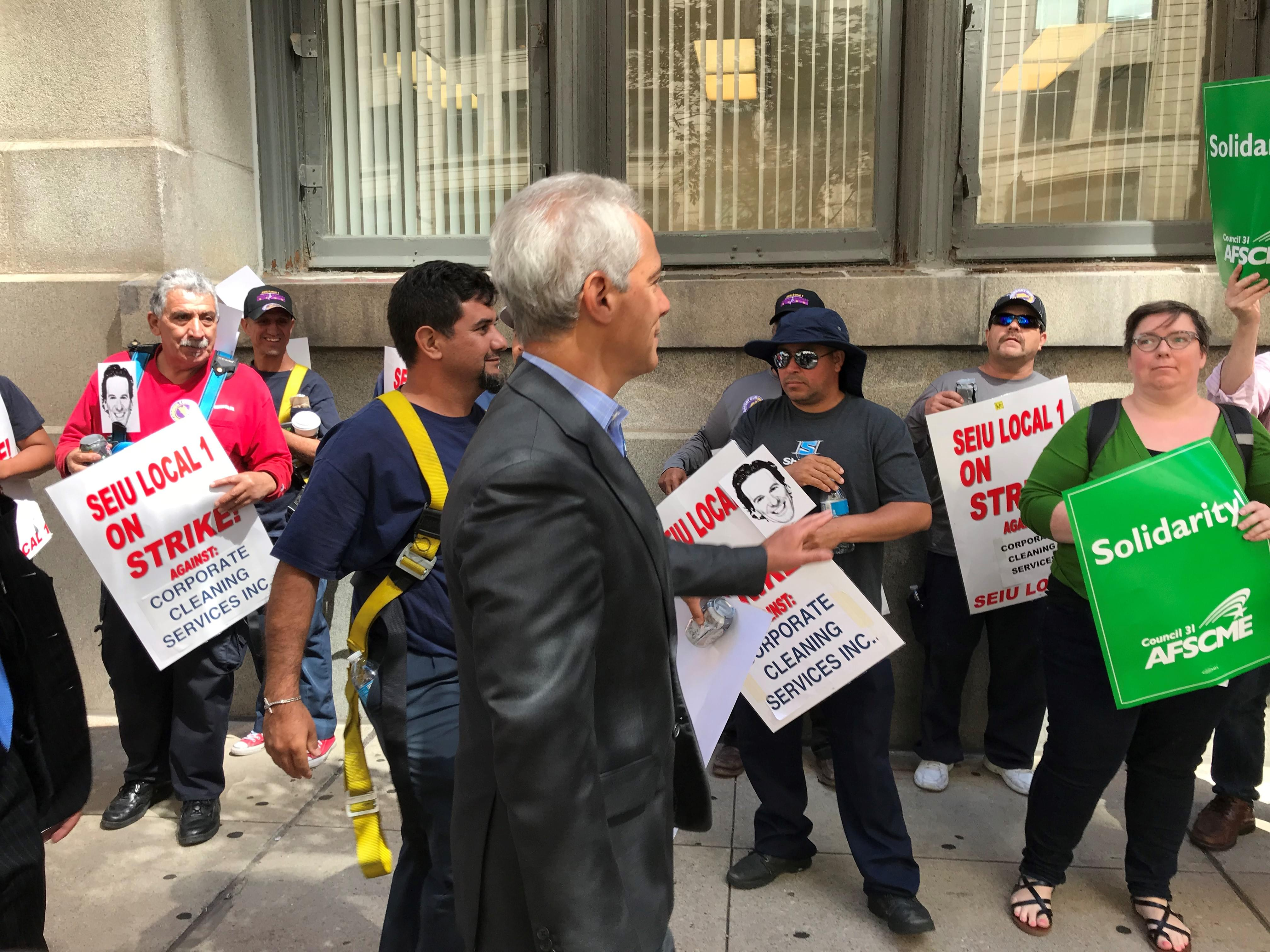 Emanuel greets strikers outside of City Hall