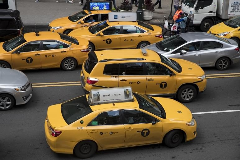 Declining Chicago taxi business banking on ride-share limits