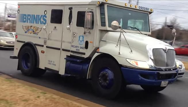 Armored truck dumps cash on indiana interstate
