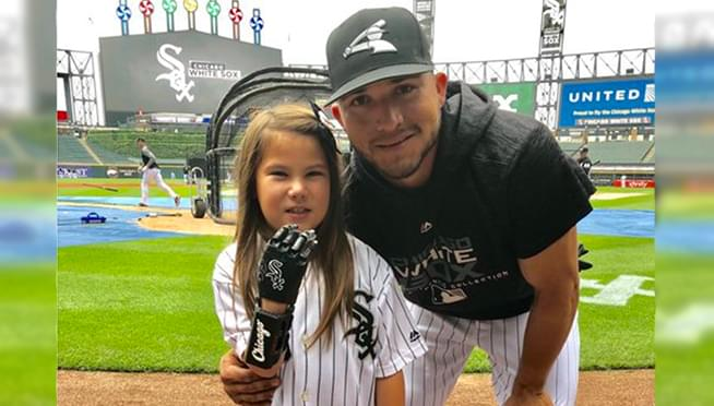 8-year-old Sox fan with 3D-printed hand throws first pitch