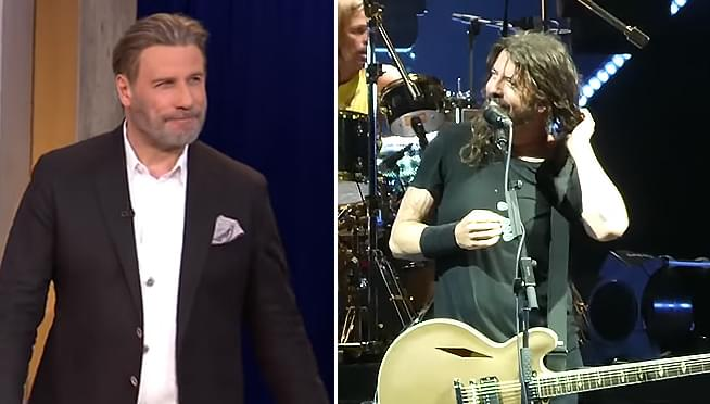 John Travolta performs with the Foo Fighters