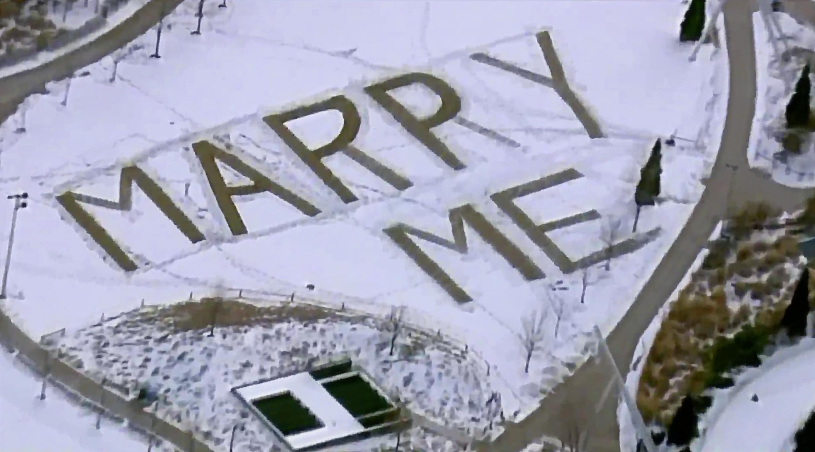 Man writes giant proposal in snow in Maggie Daley Park for girlfriend who works in a nearby skyscraper