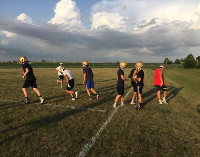 Helmets on as high school football practices begin