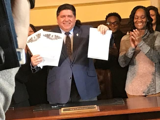 Pritzker signs bill allowing state to license gun dealers