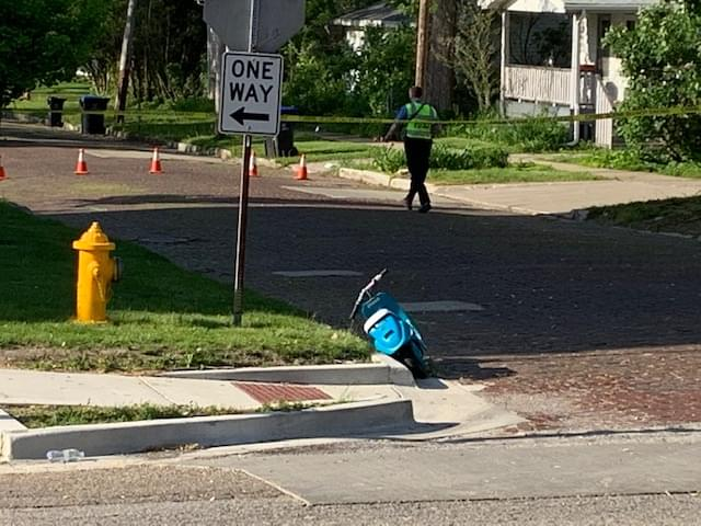 Child on scooter struck by vehicle