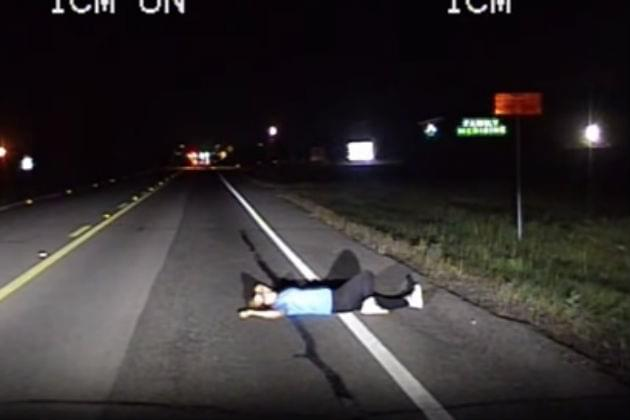 Woman Napping In Road