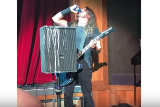 Watch Dave Grohl Fall Off Stage Immediately After Chugging a Beer [VIDEO]