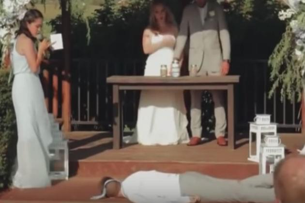 Watch This Best Man Faint In the Middle of a Bridesmaid's Not-So-Great Singing Performance [VIDEO]