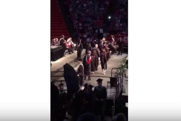 Watch This College Graduate's Backflip Attempt Fail Miserably [VIDEO]