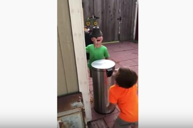 Watch These Kids Hit Each Other With A Trash Can's Lid by Stepping on It's Pedal [VIDEO]