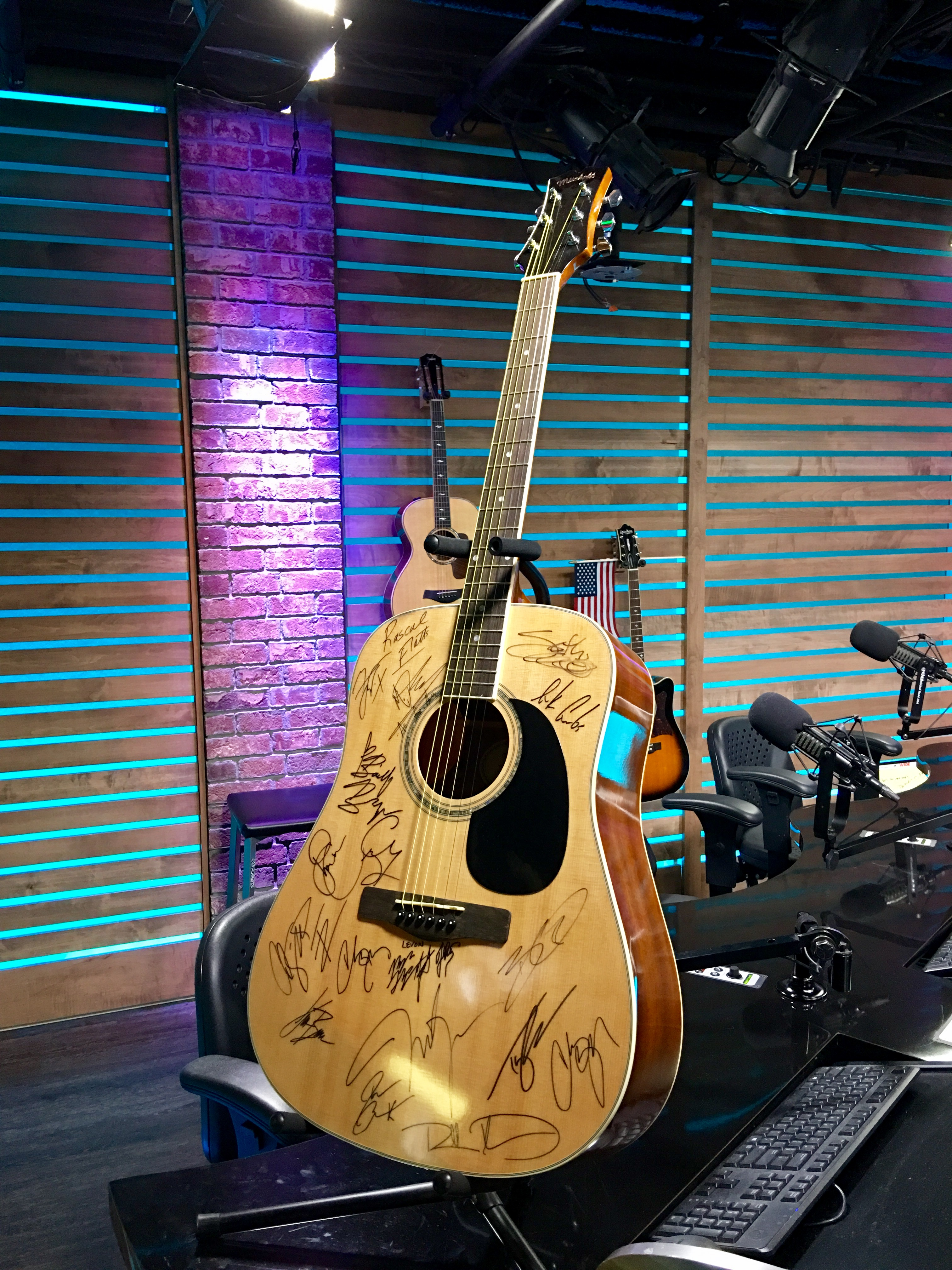 You Could Win a Guitar Signed by the Stars of Country Music