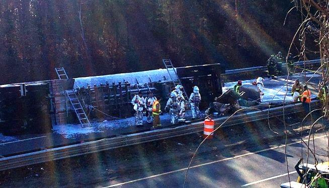 One dead, one hurt when gasoline tanker rolls on highway