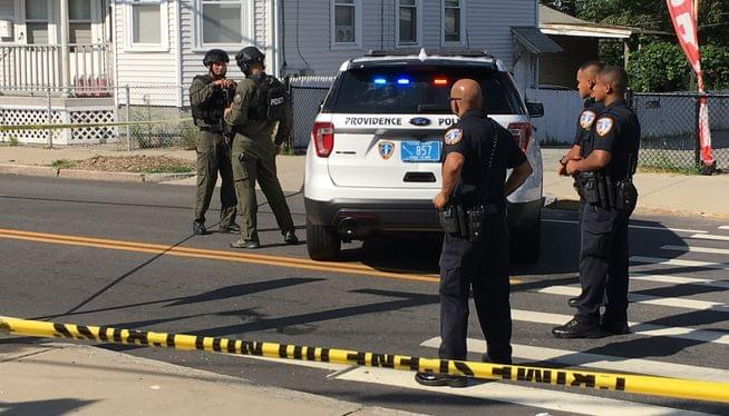 Police officer wearing bulletproof vest shot, wounded