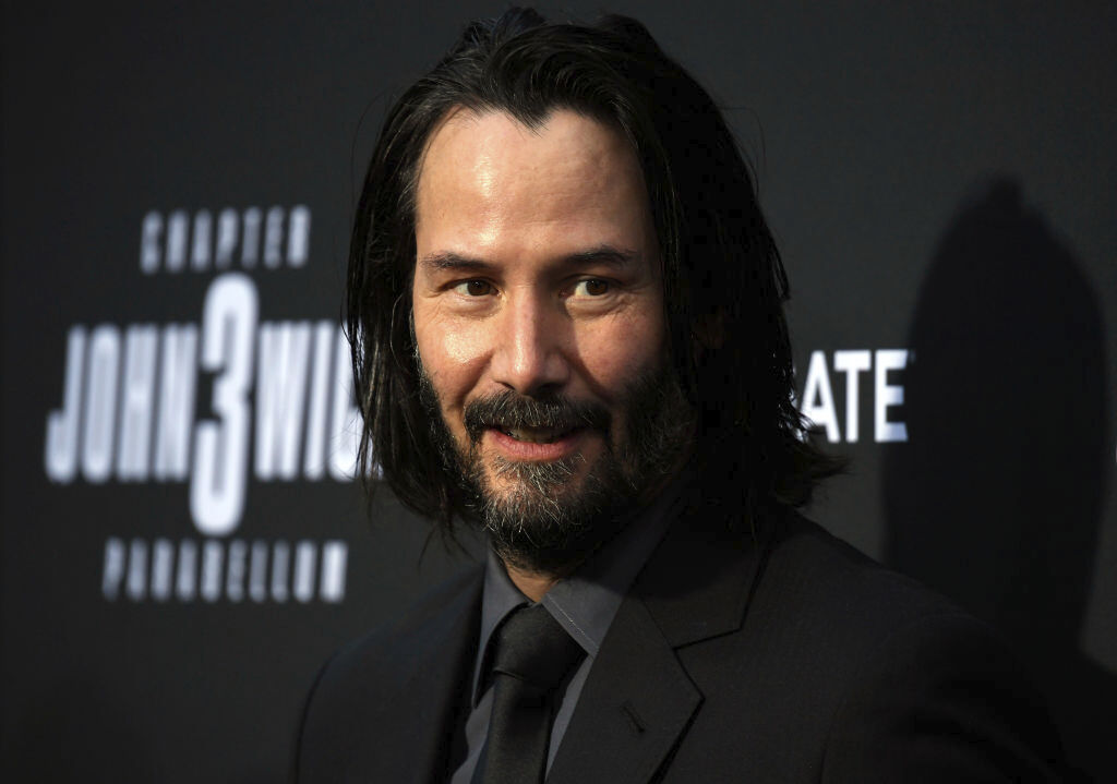 Keanu Reeves walking to music.
