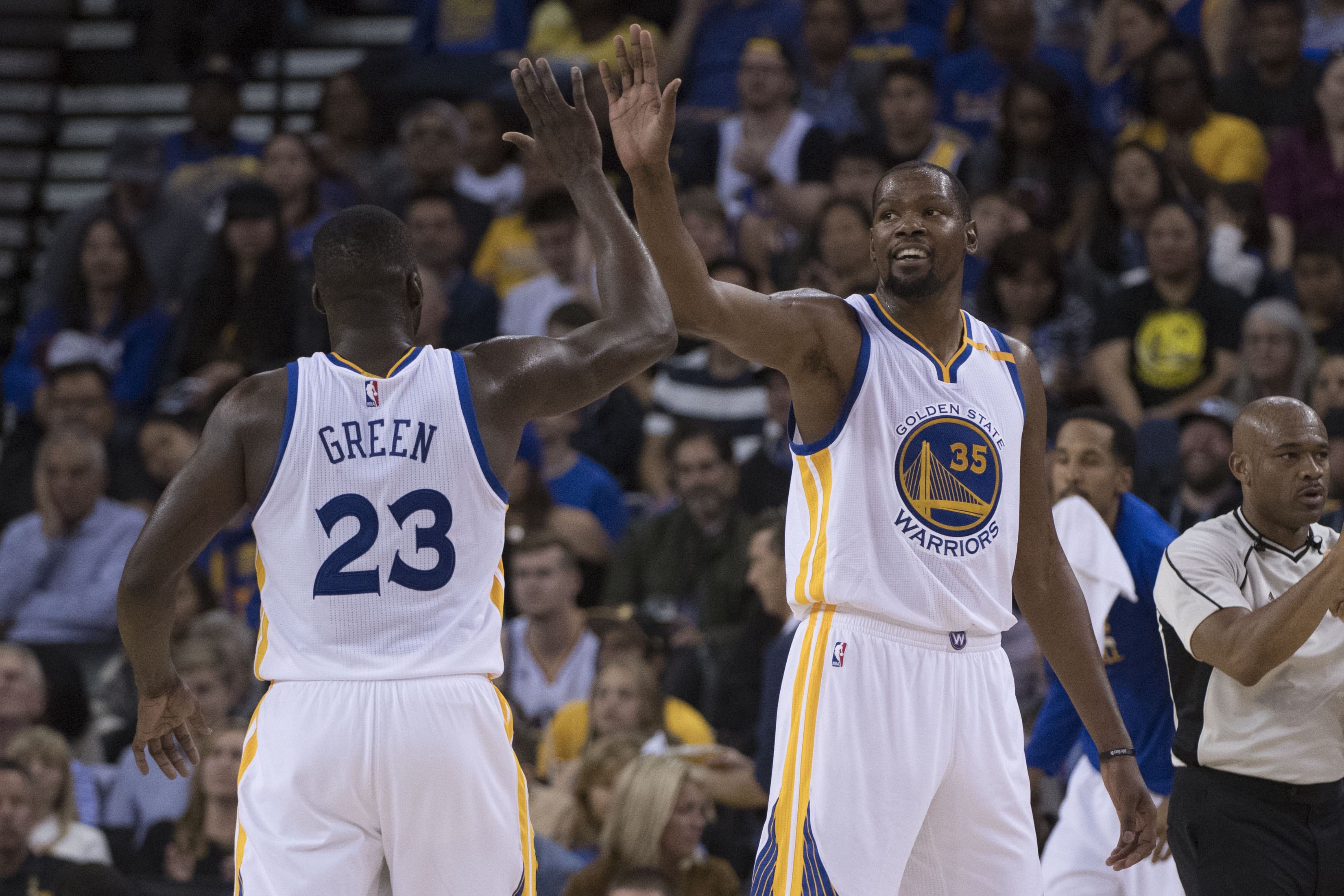 October 4, 2016; Oakland, CA, USA; Golden State Warriors forward Kevin Durant (35) celebrates with forward Draymond Green (23) against the Los Angeles Clippers during the second quarter at Oracle Arena. Mandatory Credit: Kyle Terada-USA TODAY Sports