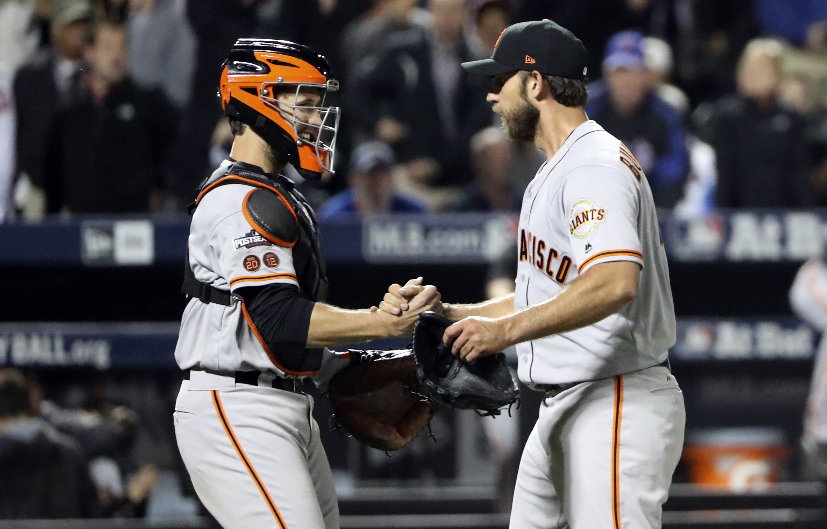 Oct 5, 2016; New York City, NY, USA; San Francisco Giants starting pitcher Madison Bumgarner (right) and  catcher Buster Posey (left) celebrate the win against the New York Mets in the National League wild card playoff baseball game at Citi Field. Mandatory Credit: Anthony Gruppuso-USA TODAY Sports