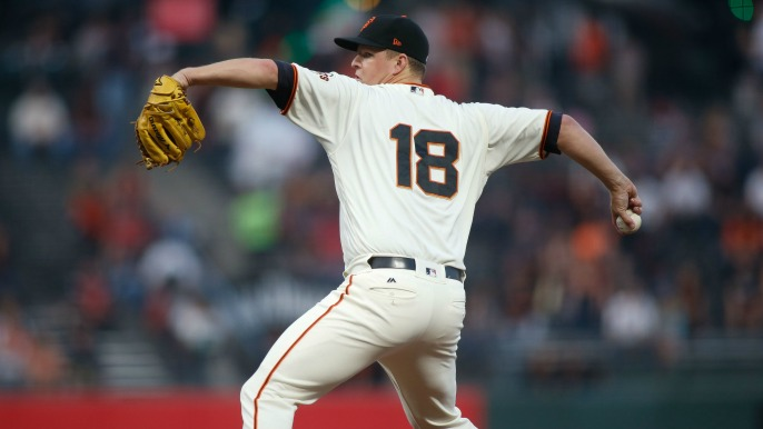 Cain battles, but Giants bats stay silent in series opening loss to Cardinals