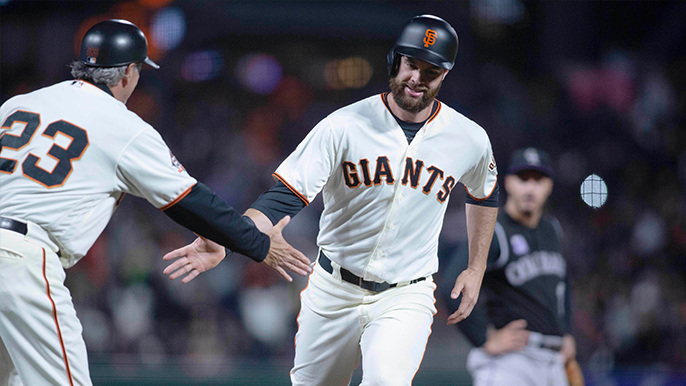 Brandon Belt tweets picture of newborn 'Watching the Giants take care of business'