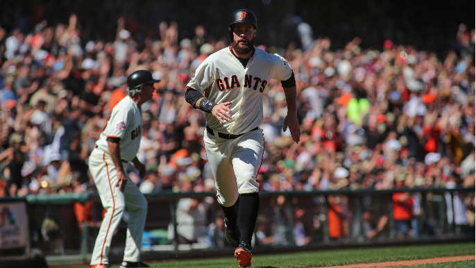 Giants call up former Braves pitcher, Belt to start rehab