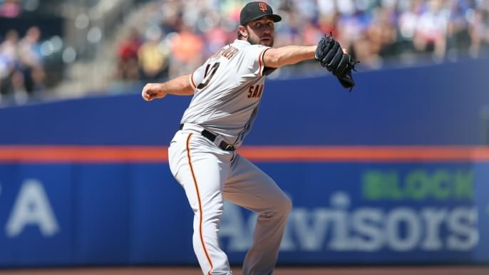 Bumgarner's pitching, hitting lead Giants to win in series finale