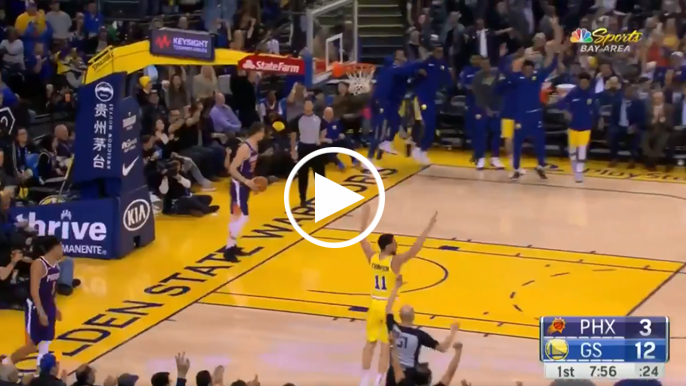 Klay Thompson throws down reverse dunk, bench goes wild