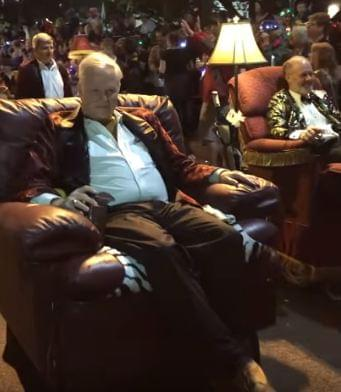 Men rolling in recliners during Mardi Gras