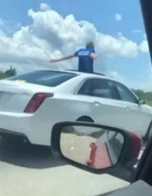 Old man caught going 100 MPH, standing through sunroof