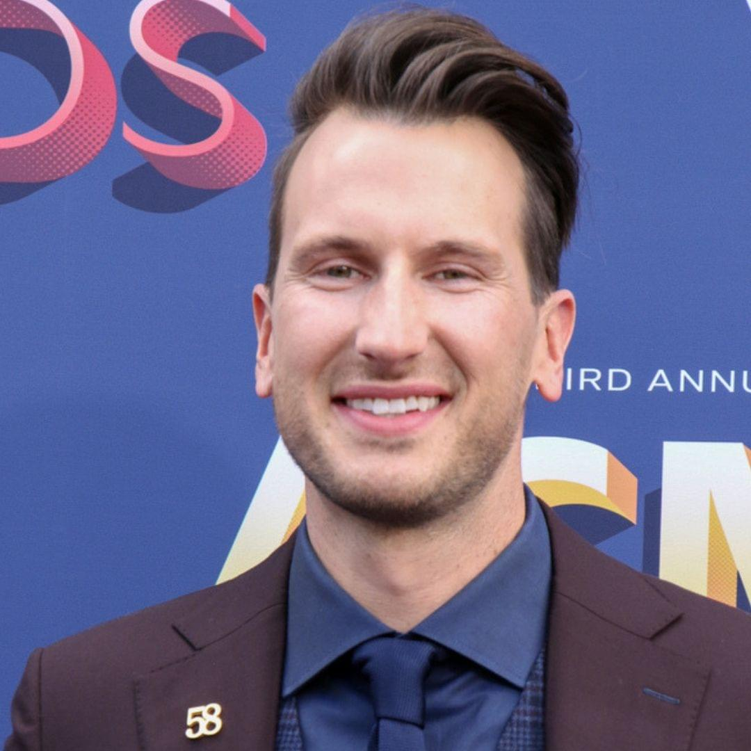Russell Dickerson Attempts to Jump Off Diving Board, Fails Miserably